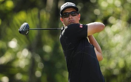 ADAM SCOTT IS USING AN EIGHT-YEAR-OLD DRIVER AT THE PLAYERS
