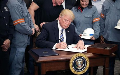 Trump signs steel and aluminum tariffs that exempt Canada and Mexico and leave door open t