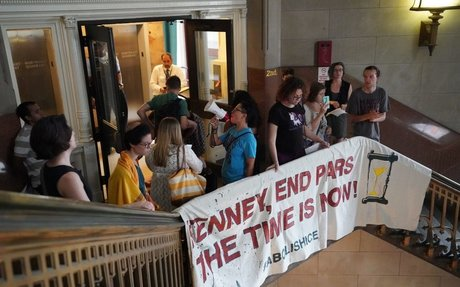 Barred from sit-in at mayor's office, Occupy ICE holds a City Hall stairwell