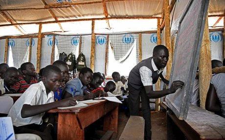 Eager refugees cram crowded classrooms in Ugandan school