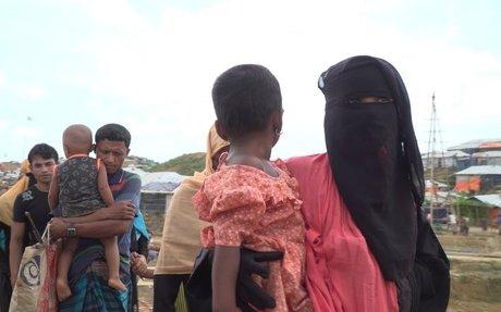 Rohingya refugees, facing landslides, get new homes