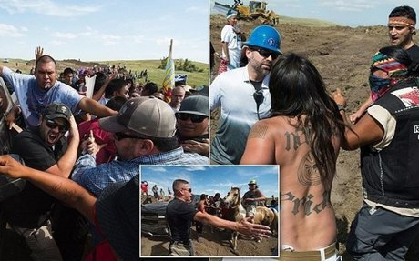 Protestors are confronted during a demonstration against oil pipeline