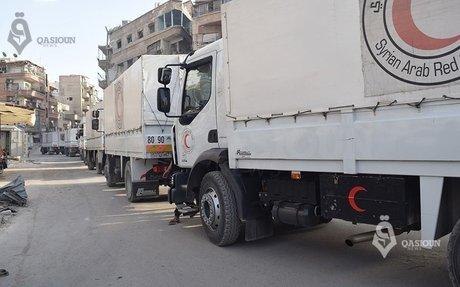 بالصور... دخول قافلة المساعدات الأممية إلى الغوطة الشرقية - وكالة قاسيون للأنباء