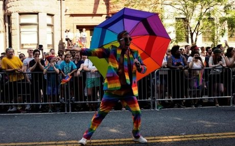 Washington gay pride parade draws thousands, briefly blocked by protest