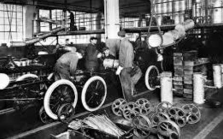 6. Ford's assembly line starts rolling