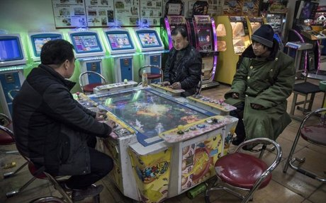China tells gaming arcades to ban children outside school holidays