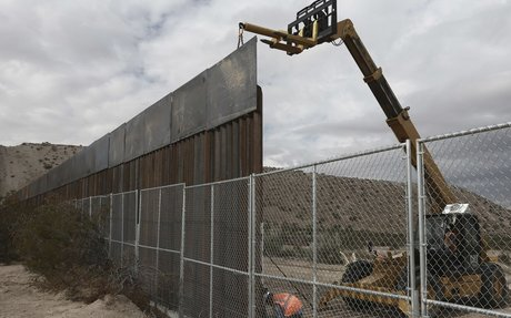 Trump says border wall will 'also help Mexico'