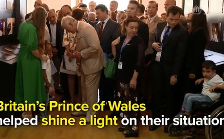 Britain's Prince Charles and Duchess of Cornwall meet refugees on Crete