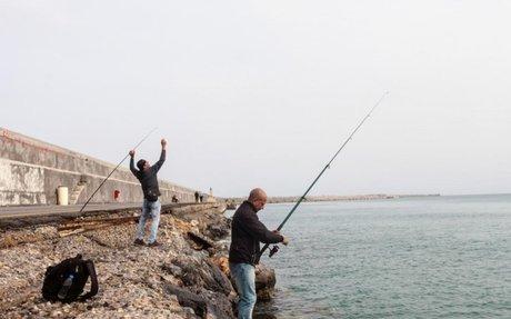 Fishing creates friendship among refugees on Crete