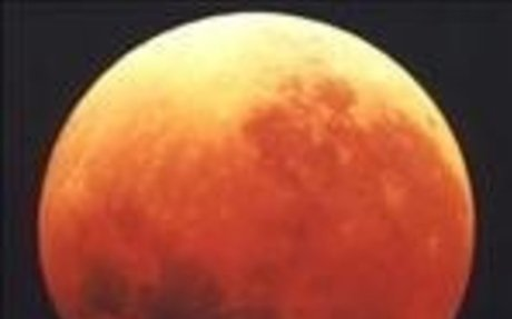 Why does the Moon turn red during a lunar eclipse?
