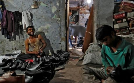 Children stitch shoes for global market in India's tourist magnet Agra