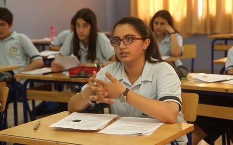Given a helping hand, Syrian schoolgirls excel in exile