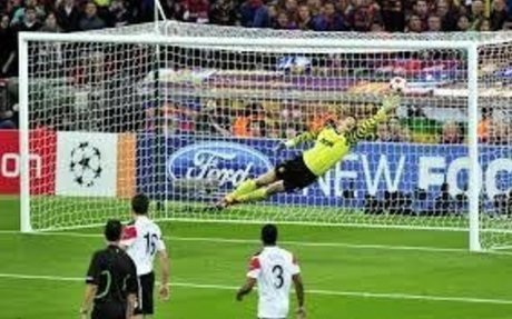 I am a goalkeeper, and I think that this goalkeeper is making a great save!