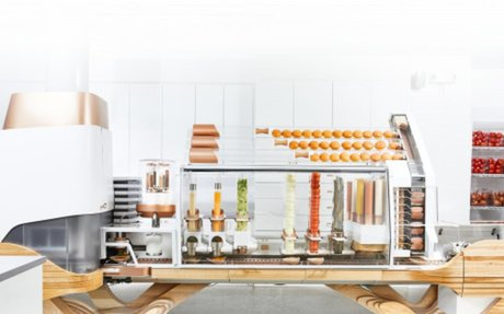 This sexy burger machine won't necessarily steal your job, but could make it better